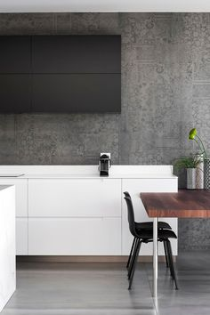 Detailed patterns that have been included on the walls of this kitchen.