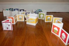 """This card had 49 cupcakes, one for each year of birth, and was 10' 8.5"""" long!!!  The box in the center is the """"envelope"""" for the card."""