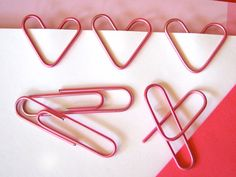 Pick up a box of jumbo red or pink paper clips and bend them into heart-shaped designs, perfect for clipping on a love note. #crafts #diy #valentinesday