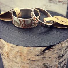 New three tone Mokume Gane couples bands! These are layered with Silver, Copper, and Shibuichi (a Japanese alloy) for a built in wood grain patterning that will last a lifetime. These rings are backed with Silver and we plate them with Platinum
