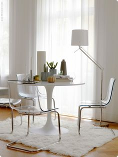 Docksta Table Lucite Chairs Over Fur Rug A Seagrass Or Jute Clear