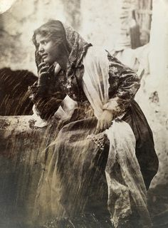 A Sicilian teenage girl draped in lace and a scarf, December 1909.Photograph by Baron Wilhelm Von Gloeden, National Geographic