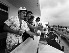 Boys will be boys! These Spring Breakers holla at people on the street from their balcony while sipping on a brew in Fort Lauderdale, Florida in 1987 -- a sight we're all too familiar with today ...