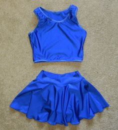 This listing is for a 2-piece bathing suit. The top is in the racer back style. The skirted bottom has a full front panty liner and a double thick