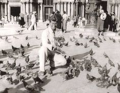 I love this - I've been right there, too! 1937. Venise. JFK feeding the birds