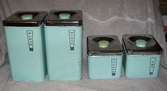 silver topped aqua blue kitchen canisters