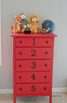 Painted red dresser with numbers - just adore this decor. I just might do this. It would help my son put away his clothes.
