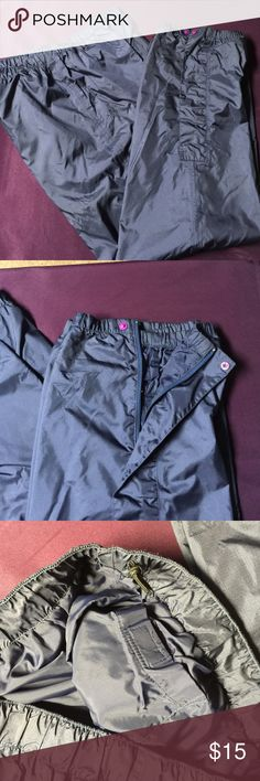 Lowe Alpine athletic pants Very nice athletic pants has wide elastic waistband with inner drawstring. An inside pocket can be found on the front for cell phone  or keys. Zippered legs with a snap for extra security. Lined throughout the garment. lowe alpine Pants Track Pants & Joggers