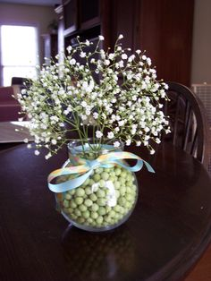 Favor for a baby shower- vase filled with fresh sweet peas and topped off with baby's breath of course!
