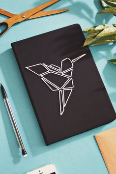 Upcycle your old note books with this easy embroidered origami book Cover DIY