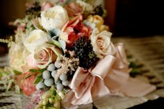 This bouquet was created with tuber roses, silver brunia, caramel antique roses, tree peony, astilibe, wheat, peppermint roses, white cabbage roses, sahara roses, privet berry, dusty miller, fiber optic grass, hellebores, and unique foliages.