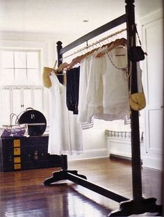Inspiration for the wooden garment rack I want my honey to build for laundry room.