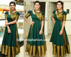 Model and actress Ashima Narwal launched Voylla Fashion Jewellery store in Hyderabad wearing a green traditional long gown that featured gold borders. Gold jewelry and a high ponytail finished off her look! Half Saree Designs, Silk Saree Blouse Designs, Fancy Blouse Designs, Dress Neck Designs, Choli Designs, Saree Gown, Sari Dress, Punjabi Dress, Sari Blouse