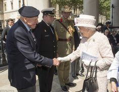 The smiling royal shakes hands with one of the veterans who looked delighted to be involve...