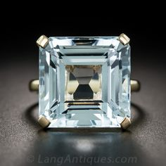 A cool refreshing blue square-cut aquamarine, weighing approximately 14 carats, is presented with straightforward mid-century minimalism in this lovely solitaire cocktail ring, crafted in yellow gold and currently ring size 5 The aqua measures ju Diamond Solitaire Rings, Diamond Gemstone, Solitaire Engagement, Vintage Engagement Rings, Gemstone Rings, Aquamarine Jewelry, Turquoise, Fine Jewelry, Jewellery