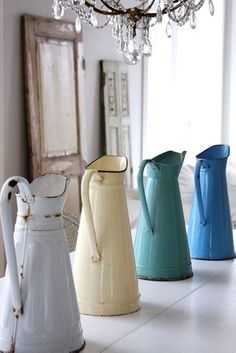 Country Decor Watering Cans. Would make great vases! Want one for the bathroom vanity.