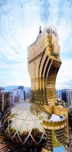 Macau, China. Designed by Hong Kong architects Dennis Lau and Ng Chun Man, the Grand Lisboa Hotel and Casino is probably the largest building in the world that looks like a pineapple.