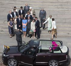 Prince Andrew took a family photo as The Queen looked on.