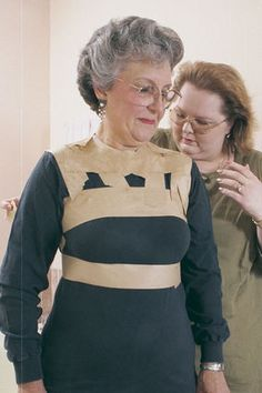 This isn't strictly knitting, but -- making a dress form that exactly fits you is one of those things that's handy no matter what. You could use duct tape, but paper tape is easier to put pins into later, and leaves less sticky residue.