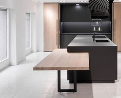 The basis of the kitchen is a simple central island that is finished in Fenix, making it highly resistant to scratches, abrasion, rubbing and high heat. A line cuts through this block creating the slot for a table surface. This table can slide. Kitchen Design Open, Contemporary Kitchen Design, Interior Design Kitchen, Kitchen Designs, Kitchen Small, Yanko Design, Kitchen Island Dining Table, Dining Room, Cuisines Design