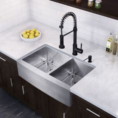 This double bowl stainless steel farmhouse sink paired with the Matte Black finish of the spiral pull-down Edison faucet will make a bold design statement in your kitchen.