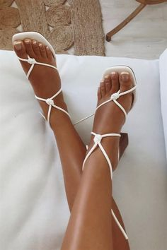 The best summer sandals could have been from the '90s. Shop our favorites here.#blockheel #opentoe #strappy #shoes #heels #blockheels #strappysandals #strappyshoe #summer #spring #leatherstraps #sandals #minimal #strappysandal #90s #kittenheel #kittenheels