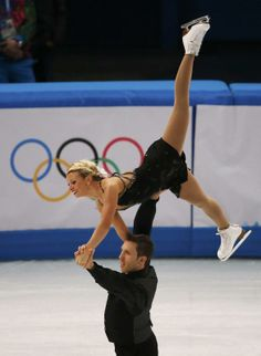 Kirsten Moore-Towers and Dylan Moscovitch of Canada compete during the Team Pairs Free Skating Program at the Sochi 2014 Winter Olympics, Fe...