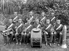 Derry's Private Band, outdoors, with instruments, probably ...