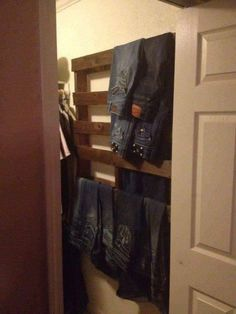pallet hung in the closet on the wall…. for your jeans.pallet hung in the closet on the wall…. for your jeans.