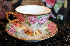 Porcelain tea cup and saucer with roses.  by AnythingDiscovered