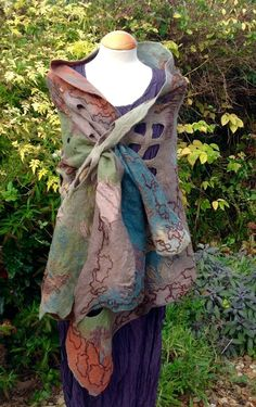 Nuno and lattice felted wool & silk shawl made with pieces of upcycled silk fabric and soft merino wool fibre in a muted palate of greens, blues, browns and gold and some hints of terracotta and bronze. The shawl has beautiful textural areas created by the lattice felting where you can
