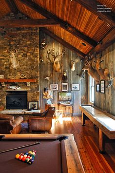 From the deer heads, exposed brick and re-purposed wood paneling this man cave screams adventurous male. #manly #interest
