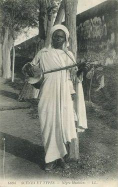 Moorish man playing the sacred Lotar instrument.