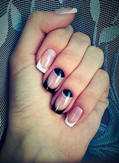 A classic French tip will never go out of style. But add a black French tip with black half moon design and it's bound to become fun as well.