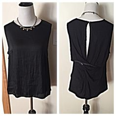 NWOT Anthro Dolan LA black top Sophisticated and simple. Front panel is silky fabric and the back is made of overlapping twisted layers of jersey fabric with silky trim. Rayon spandex. Brand new without tags. Anthropologie Tops Blouses