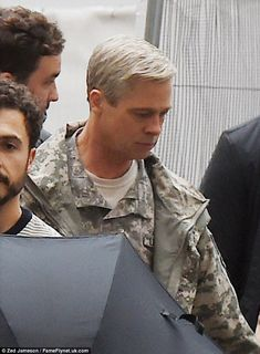 New look: Brad Pitt unveiled a new silver hairdo as he made an appearance on the London set of  satirical comedy War Machine last week