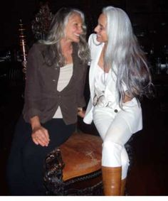 "Although these two women have gray hair, I love their outfits, especially the woman in the white outfit; it's a youthful look that doesn't make her look like she's dressed too young for her age.  I'm also so sick of posts/pins that show pictures of hairstyles for women ""over 40"" or ""over 50"".  What law says women can't have long hear once we've reached a certain age?!"