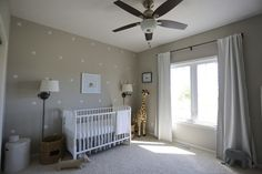 A gender neutral gray zoo themed nursery. I fell in love with an animal theme. It began with a giraffe, then an elephant and we threw in dachshunds too!
