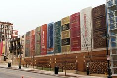 Must visit Kansas City Public Library's Community Bookshelf. The exterior is decorated with more than 20 book spines with diverse titles that range from literary masterpieces to works by local authors and from adult fiction to children's classics.