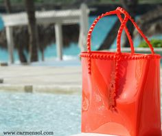 Crafted in Italy from non-toxic jelly material, all of Carmen Sol's designs are made for fun in the sun and sand.Carmen Sol Benefits include: eco-conscious, water Resistant, Slip Resistant, Rose Scented, Made in Italy. Available in 14 Dazzling Colors #colorful #bags #shoes #summerfashion #beach #beachbody #beachinspiration #summerwear#summeroutfit2017#summerstyle #resortwear #resortstyle
