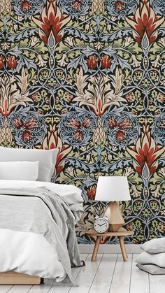 Give your bedroom a William Morris makeover with one of his beautifully intricate patterns. Place this Snakeshead design behind your bed with no headboard and style with light grey and white bedding. Choose wooden furniture to bring in a more natural feel and warm up the space, whilst mirroring the neutral tones in this floral design. Shop the look at Wallsauce.com!
