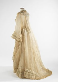 "Dress, Evening  Date:      ca. 1872  In the early 1870s, prior to her marriage, Amelia altered the dress into its current polonaise style when, ""on very short notice for a party '[she had] nothing to wear.'"" The delicacy of the organdy and mull and the beautiful execution of the alteration exemplify Amelia Beard's resourcefulness and talent with dressmaking."