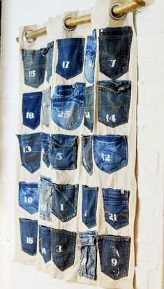 Simple To Make Jeans Handmade Advent Calendar - Pillar Box Blue - - Recycle your families old jeans pockets into a fabulous handmade advent calendar. Really simple step by step tutorial with no sewing involved. Jean Crafts, Denim Crafts, Upcycled Crafts, Homemade Advent Calendars, Diy Advent Calendar, Calendar Ideas, Artisanats Denim, Denim Purse, Mollie Makes