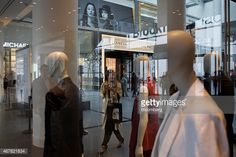 467821834-the-reflections-of-attendees-are-seen-in-the-gettyimages.jpg (594×396)