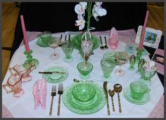 I haven't seen depression glass settings decoration in a long while.  Very cute though.