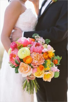 colorful bouquet of peonies, garden roses, sweet peas, ranunculus and Icelandic poppies by The Little Branch