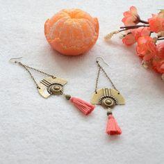 Boucles d'oreilles oranges bronzes et pompons