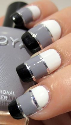 Striping tape in silver blocks off these nails into 3 color blocks. Shades used here are: Zoya Purity, Carey (gray), and Raven (black that has a slight shimmer to it - it's not a black cream) New Year's Nails, Great Nails, Fabulous Nails, Love Nails, How To Do Nails, Fun Nails, Hair And Nails, Amazing Nails, Black Nail Designs