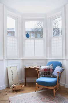 window film that makes your glass look frosted. this photo reminds me of all the bay windows in SF