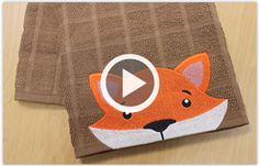 Free videos with instructions on how to embroider a towel border with an animal design, embroider flour sack towels, & more